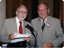 Howard Harrison, MD, presents Francis Banich, MD, his 50-year Certificate