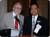 Howard Harrison, MD, presents Melecio Flores, MD, his 50-year Certificate.