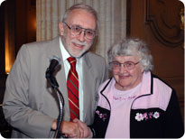 Howard Harrison, MD, presents Novella Ann Schafer, MD, her 50-year Certificate.
